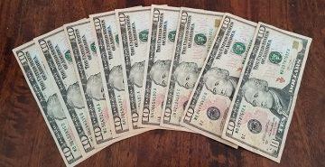 10-dollar bills laid on a table