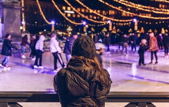 Woman watching people ice skating